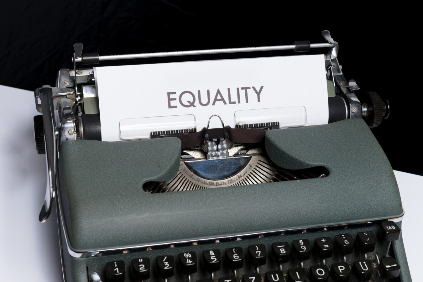 an image showing typed pay equality on a paper