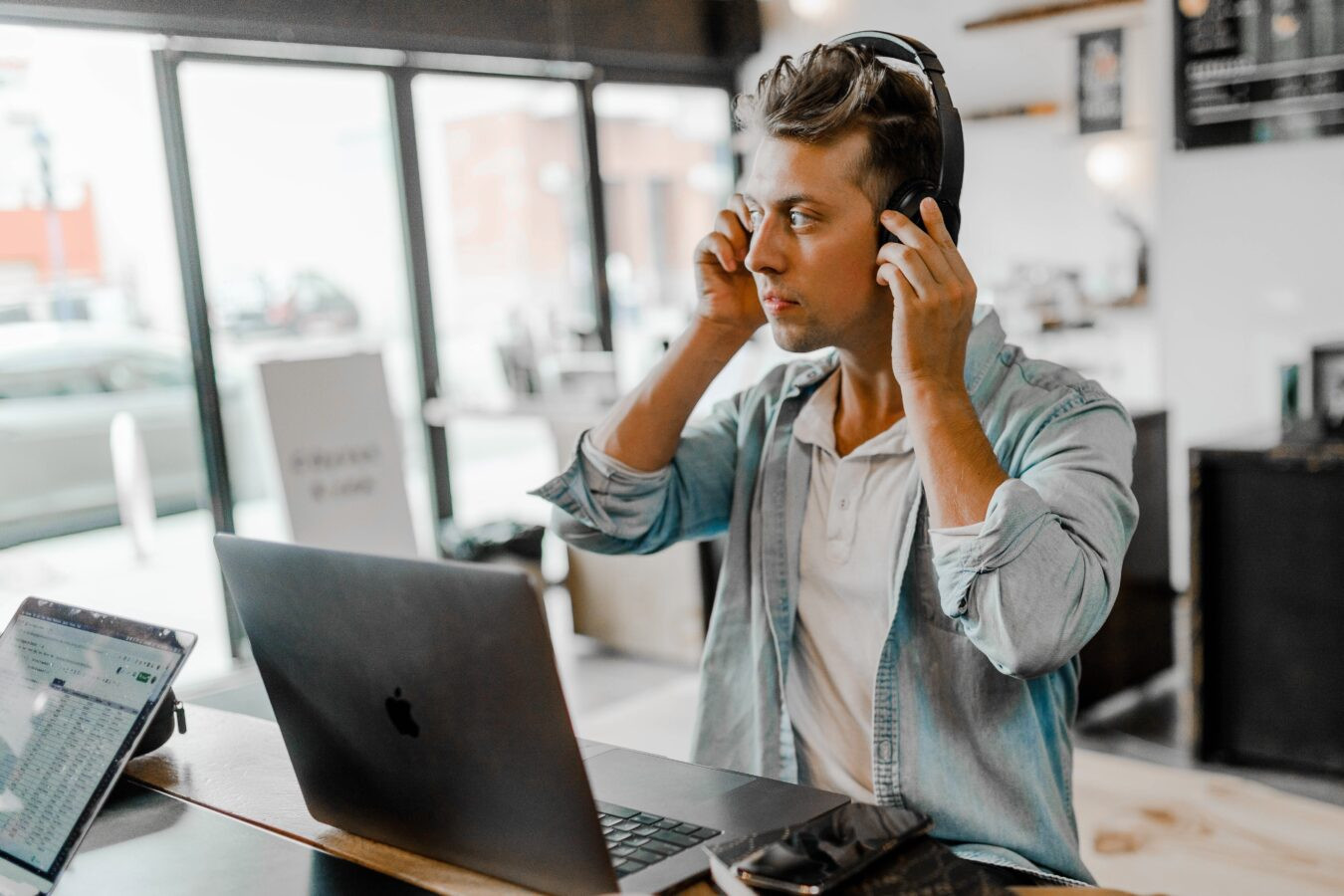 an image showing a guy in a contact centre with his headphones
