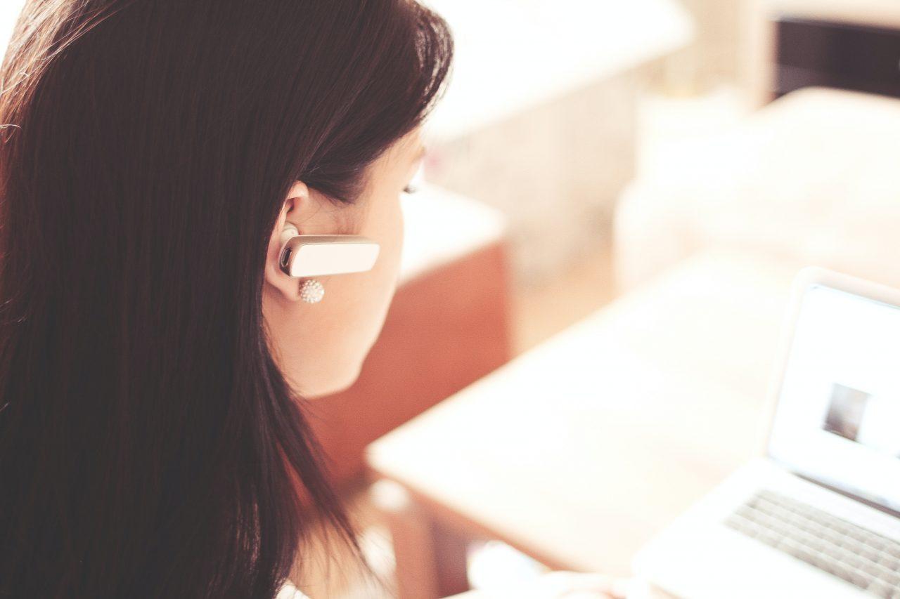 woman-wearing-earpiece-using-white-laptop-computer-210647-1280x853.jpg