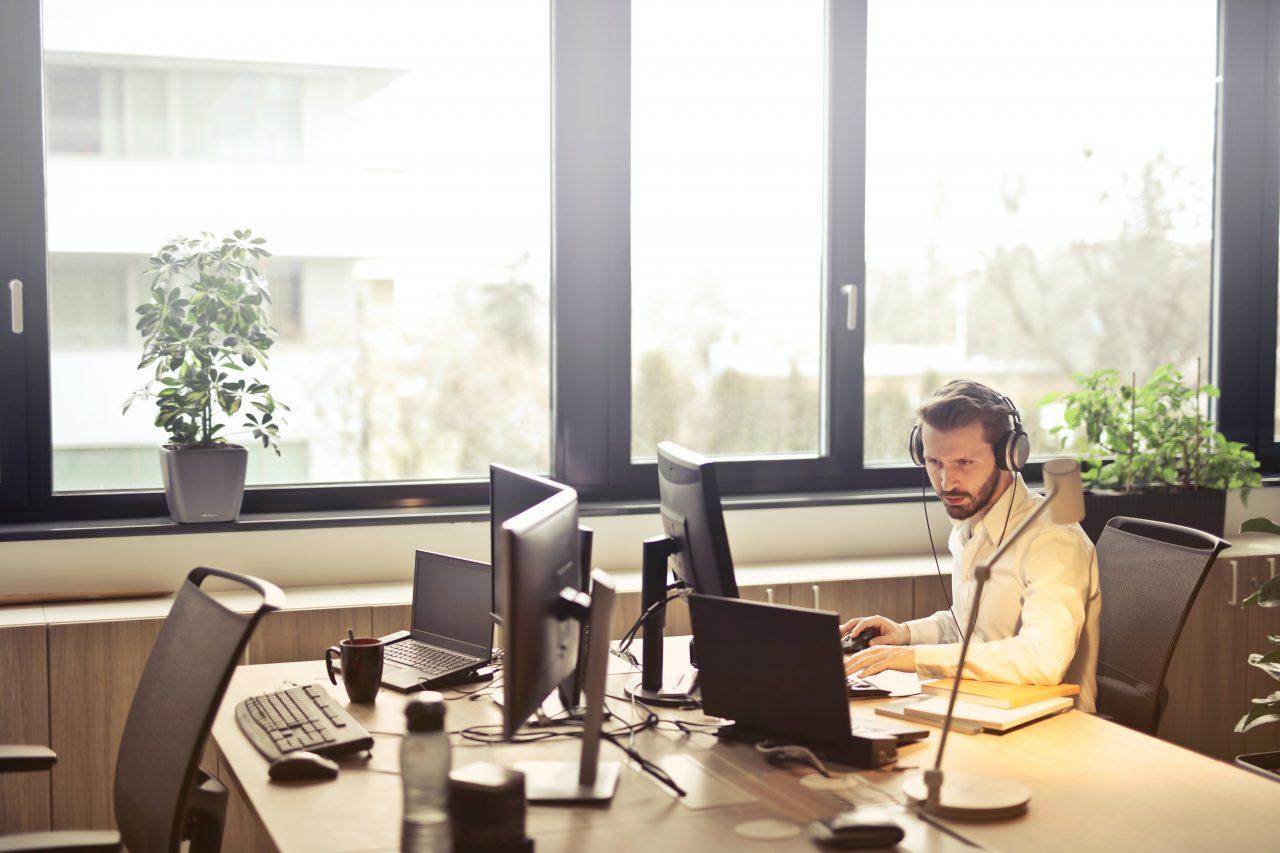 man-with-headphones-facing-computer-monitor-845451-1280x853.jpg