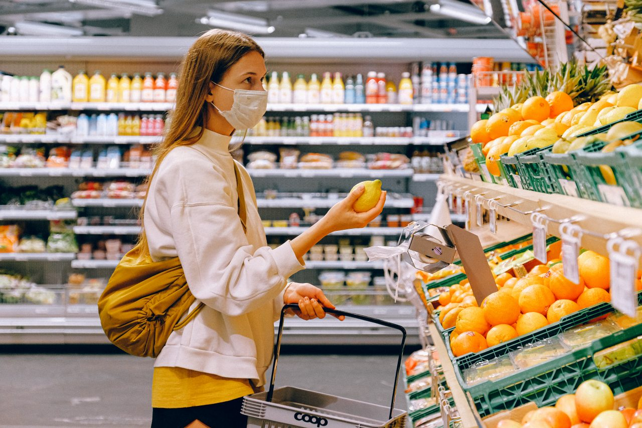 woman-in-yellow-tshirt-and-beige-jacket-holding-a-fruit-3962285-1280x853.jpg