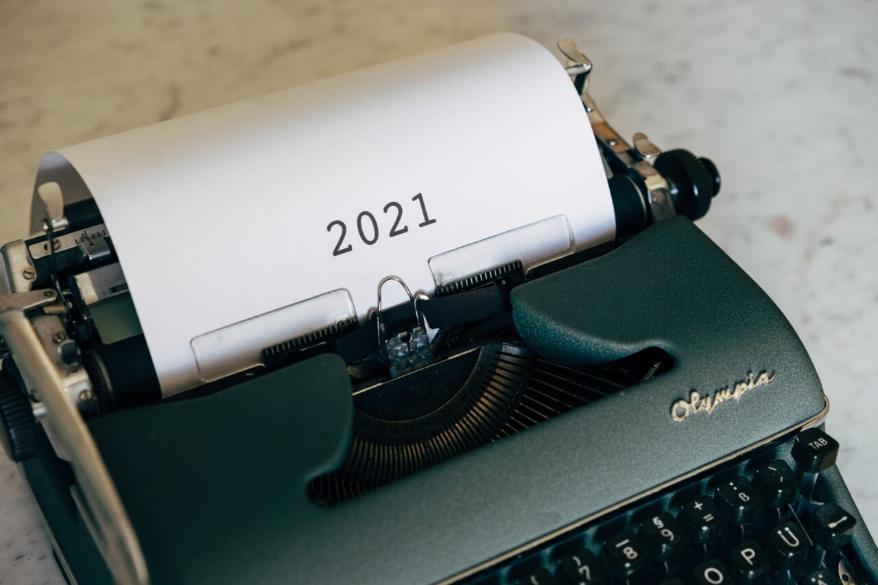 The top customer experience trends in 2021 represented on the paper with a year written on it.