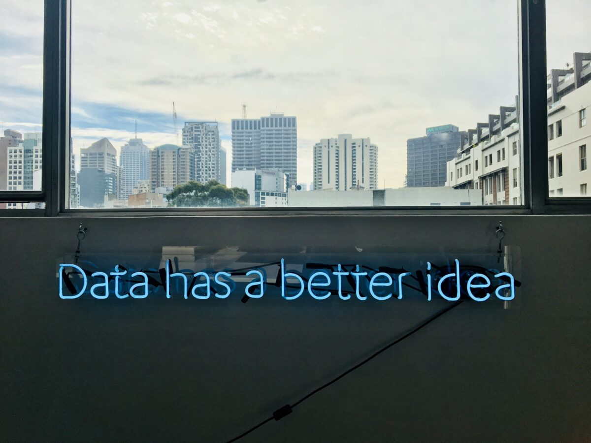 A neon sign shows words: data has a better idea of a winning customer experience.