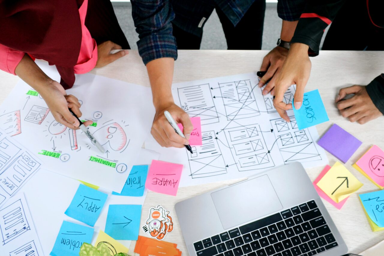 A team of employees work on the papers to understand the perfect customer experience journey.