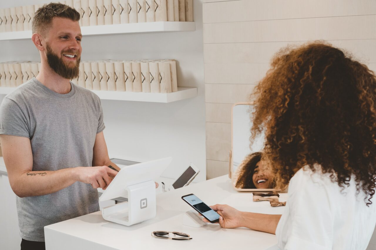 A cashier conducts one of the customer surveys in the store.