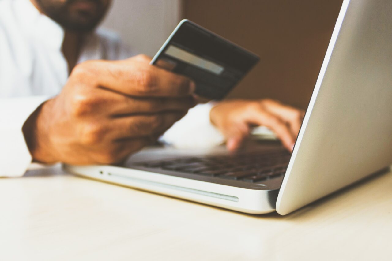 Man using a credit card for online retail services