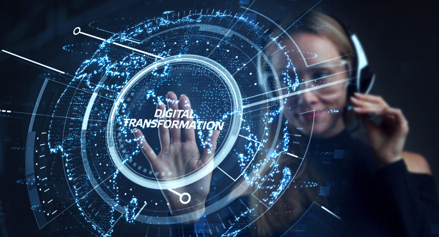 A human agent touching the virtual representation of digital transformation