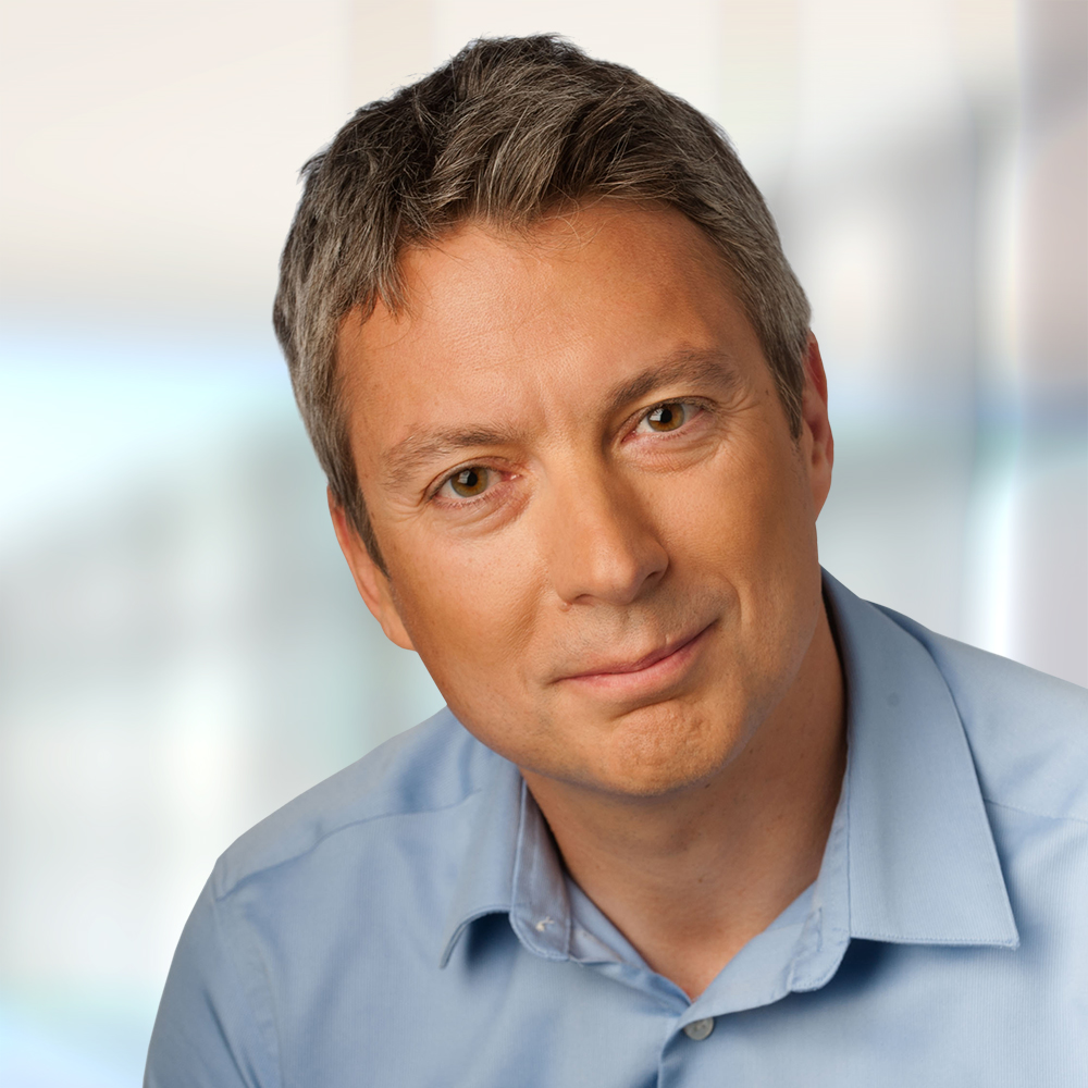 A headshot of an interviewee Barry Cooper, President at NICE, who talks about smart technology.