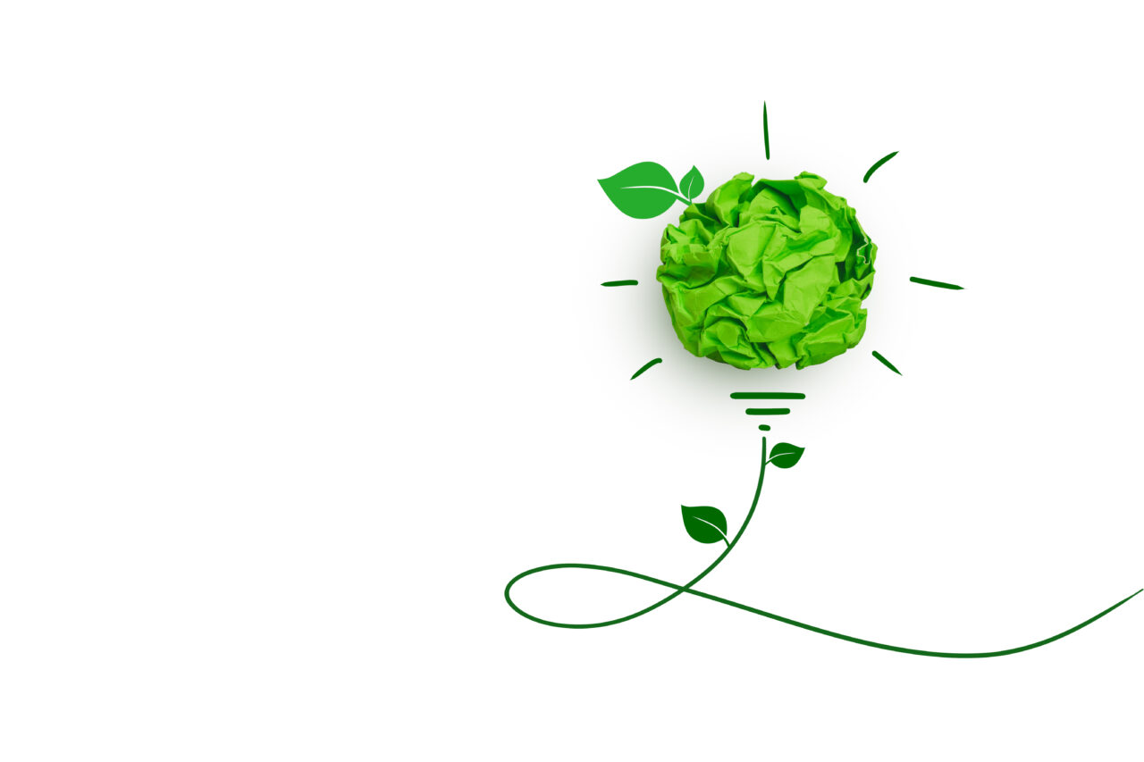 Green papers form a bulb, therefore, representing an idea about sustainability.