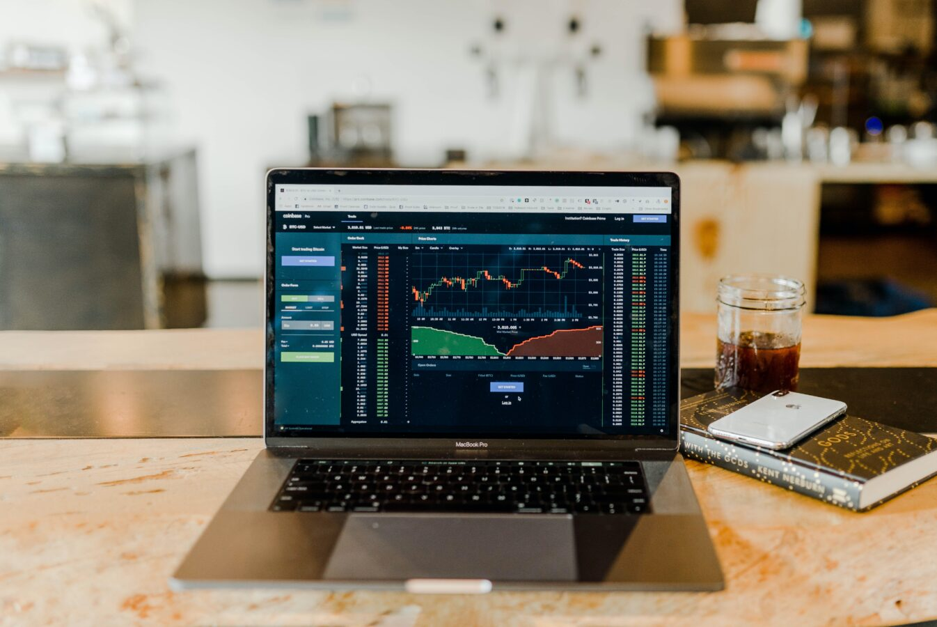 A laptop on the desk is used for trading cryptocurrency.