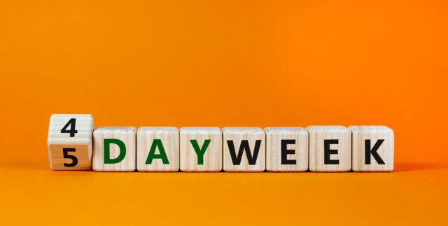 4-day work week written on wood blocks.