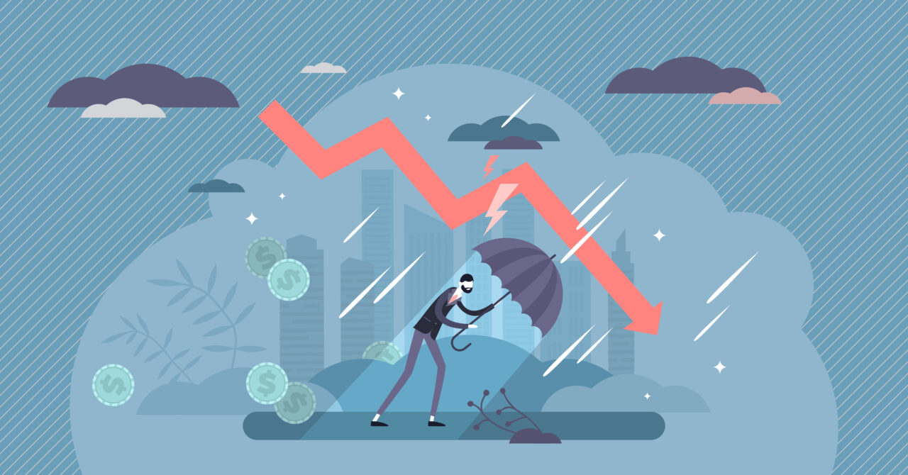 An illustration shows a person guarding itself with an umbrella against the global economic crisis.