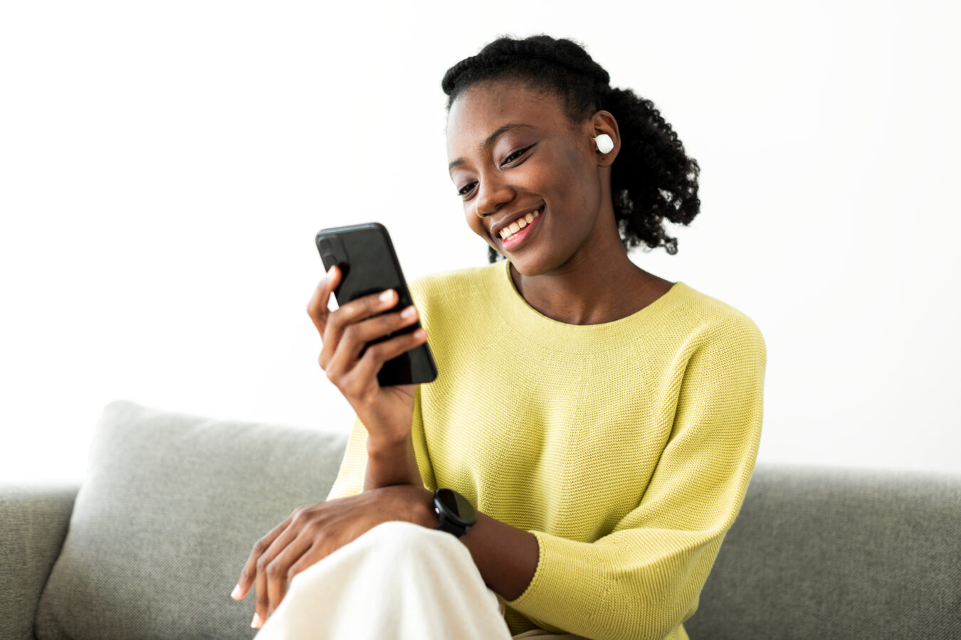 A woman uses her phone to go through the digital customer journey.