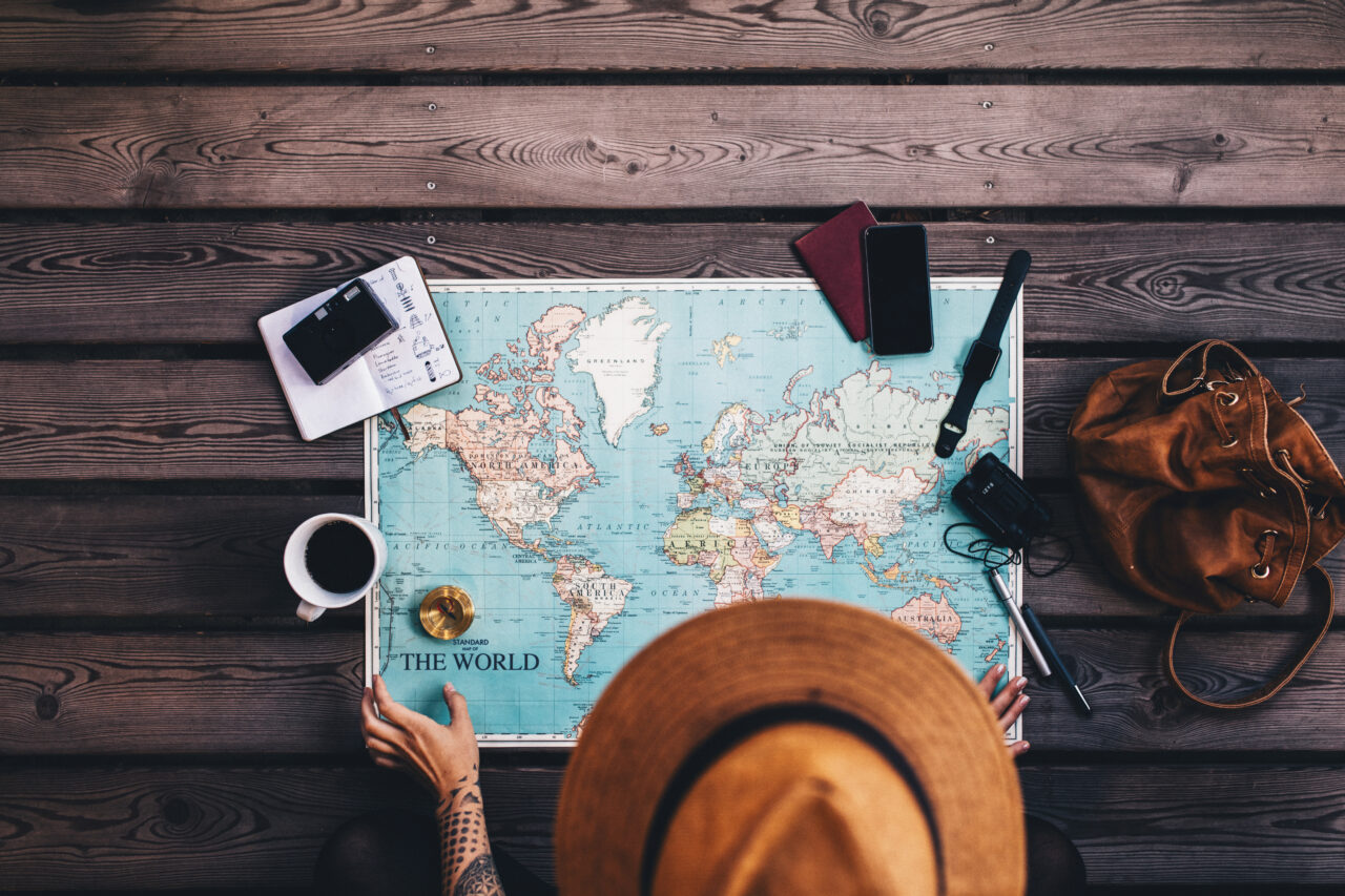 an image of a person with a map planning travel booking experience