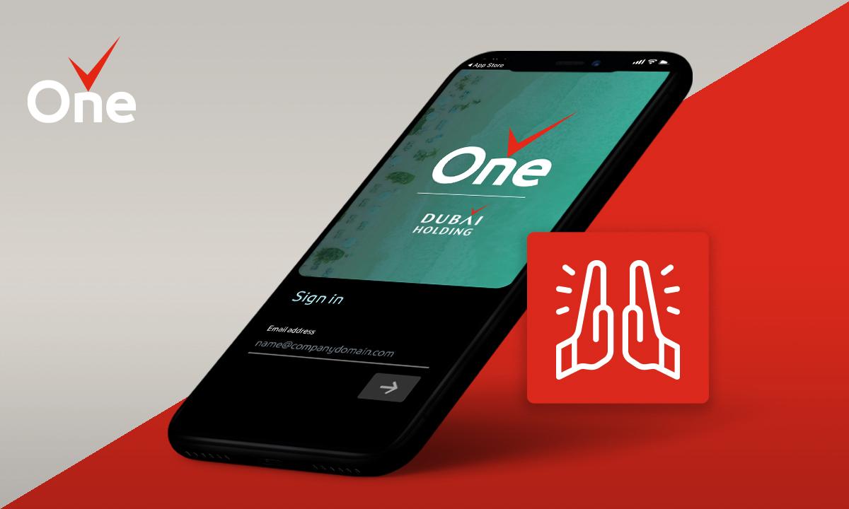 Dubai Holding app is showed on a smartphone.