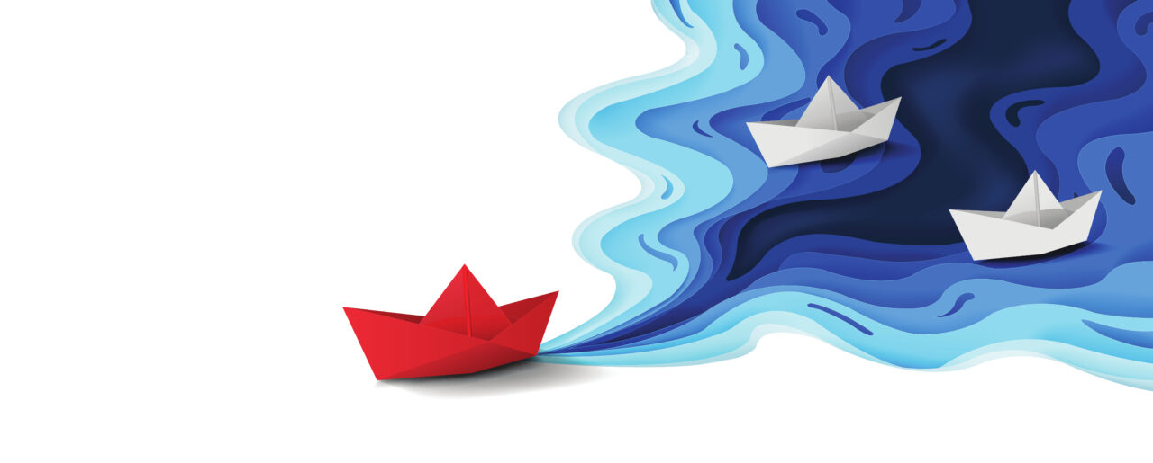 A red paper boat goes ahead of others because of the purpose-led leadership approach.