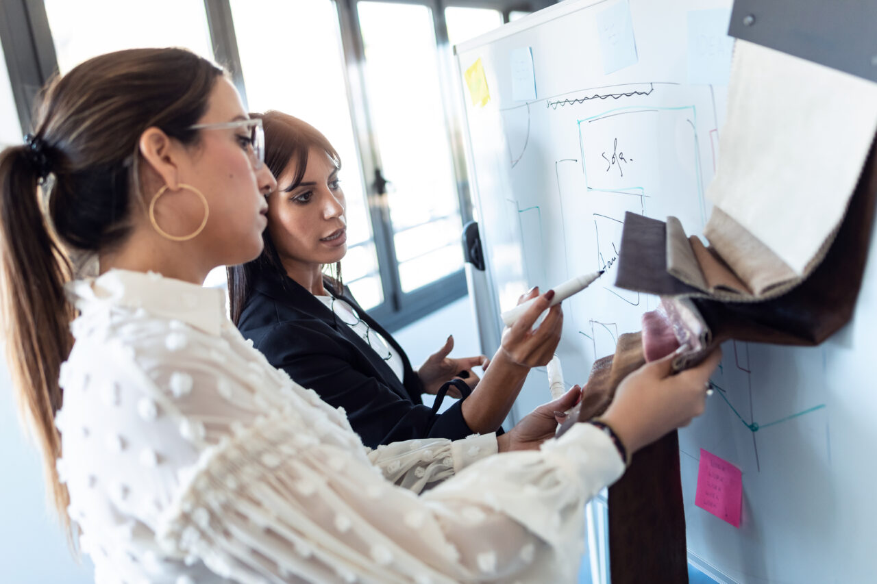 an image showing two women designing a customer service process.