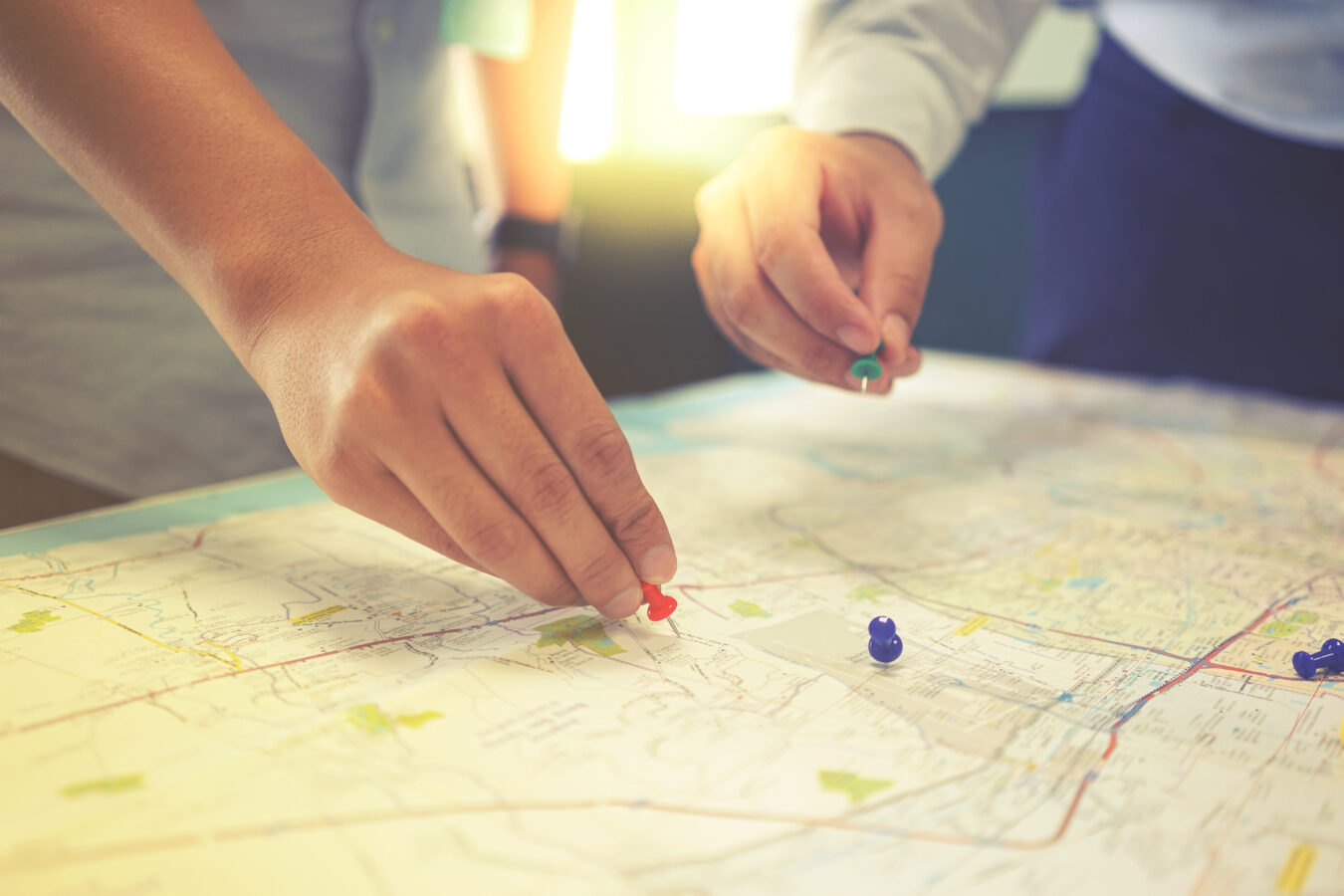 Two people look at the map that represent customer value journey.